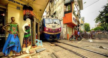 This railway line in Hanoi is several inches away from the doorsteps of buildings!
