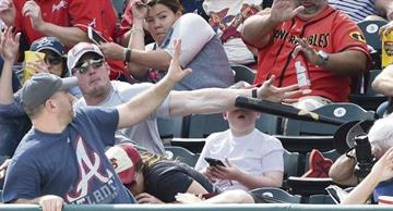 A baseball fan saved a boy from a flying bat!