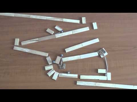 Incredible video of a Marbomino in action – a marble machine that uses marbles, magnets and a lot of wooden bars!
