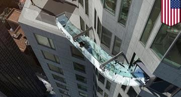 Would you dare to ride down a 1,000ft high glass slide?
