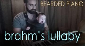 The touching moment: the best father in the world sings his cute baby to sleep