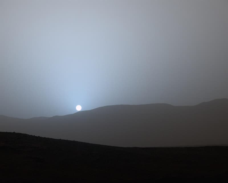 Science Story: #3 The sunset on Mars, captured by NASA's Spirit space rover. All sunsets on Mars are blue because of the planet's tenuous atmosphere