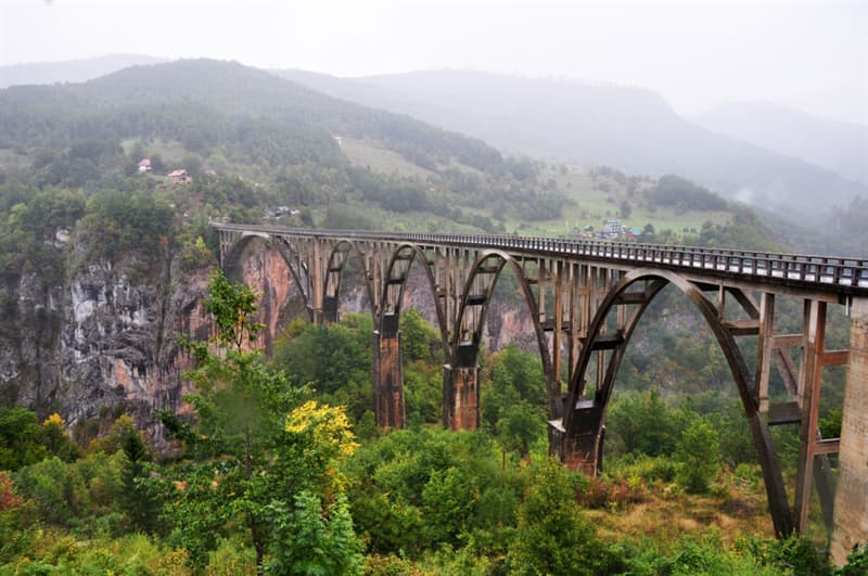 Geography Story: #2 The Durdevica Tara bridge above the Tara river in Montenegro providing the remarkable view of the canyon