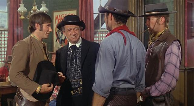 Movies & TV Trivia Question: What was the name of the western town in the film 'Carry On Cowboy'?