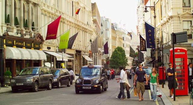 Society Trivia Question: Which famous London street is revered throughout the world for its wealth of elegant stores, exclusive brands, designer fashion, and luxury goods?