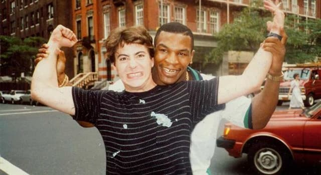 Society Trivia Question: Who is in the picture with Mike Tyson?