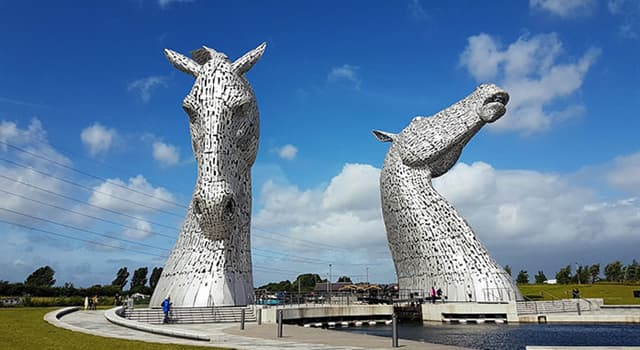 Culture Trivia Question: Where can one find the two 100 ft high stainless steel horse-head sculptures shown below?