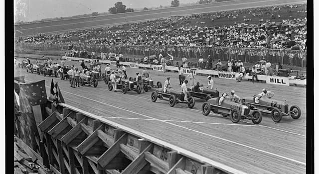 Sport Trivia Question: In which year did the winning race car first exceed 100 mph in the Indianapolis 500 automobile race?