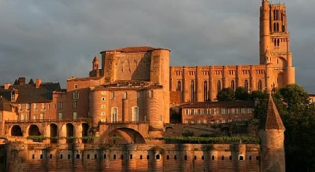 Society Trivia Question: The largest red brick cathedral in the world is in which town in southern France?