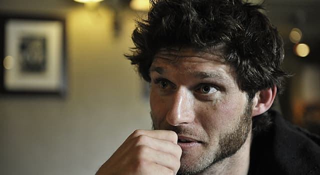 Sport Trivia Question: TV presenter Guy Martin made his name participating in which sport?