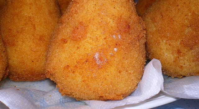 Culture Trivia Question: What volcano in eastern Sicily inspired the shape of the rice balls in the dish 'Arancini'?