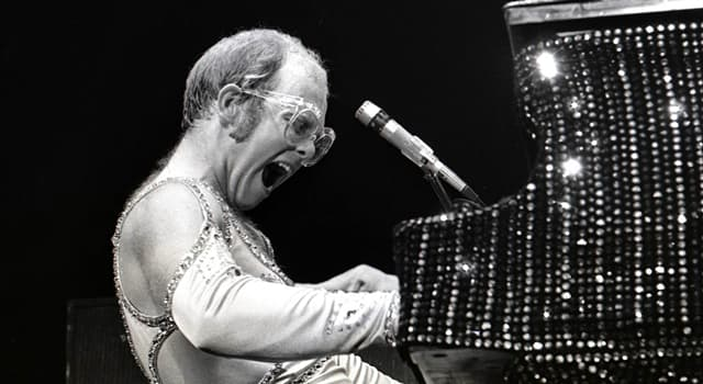 Society Trivia Question: Who made a surprise appearance at Elton John's concert at Madison Square Garden in 1974?