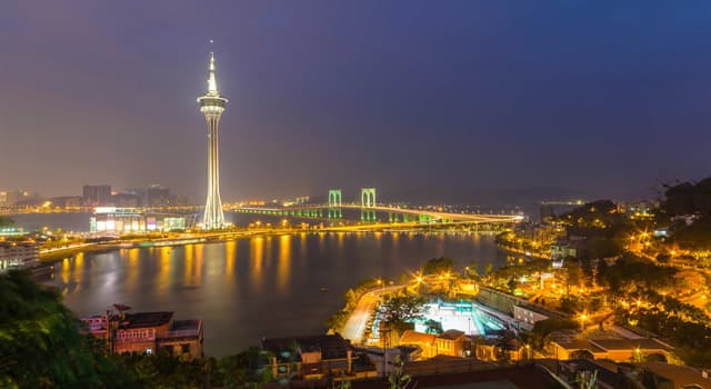 History Trivia Question: How many years did the Portuguese rule Macau before it was transferred back to China?
