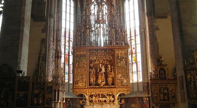 Geography Trivia Question: In which country will you find the world's tallest wooden altar?