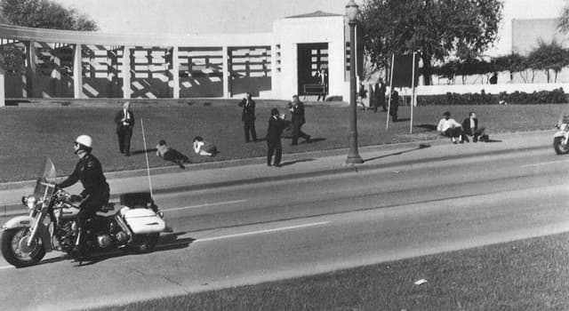 History Trivia Question: What was in the hands of Louie Steven Witt who was suspected in Kennedy's assassination?