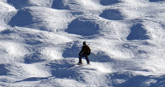 Sport Trivia Question: In which event do skiers descend a slope covered in mounds of snow, making jumps during the descent?